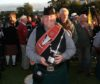 Renowned pipe band enthusiast Paul Brown with the World Pipe Band Championship trophy.