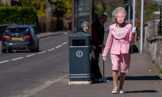 Pensioner Hazel MacFadyen begins first of 45 daily walks dressed as the Queen.