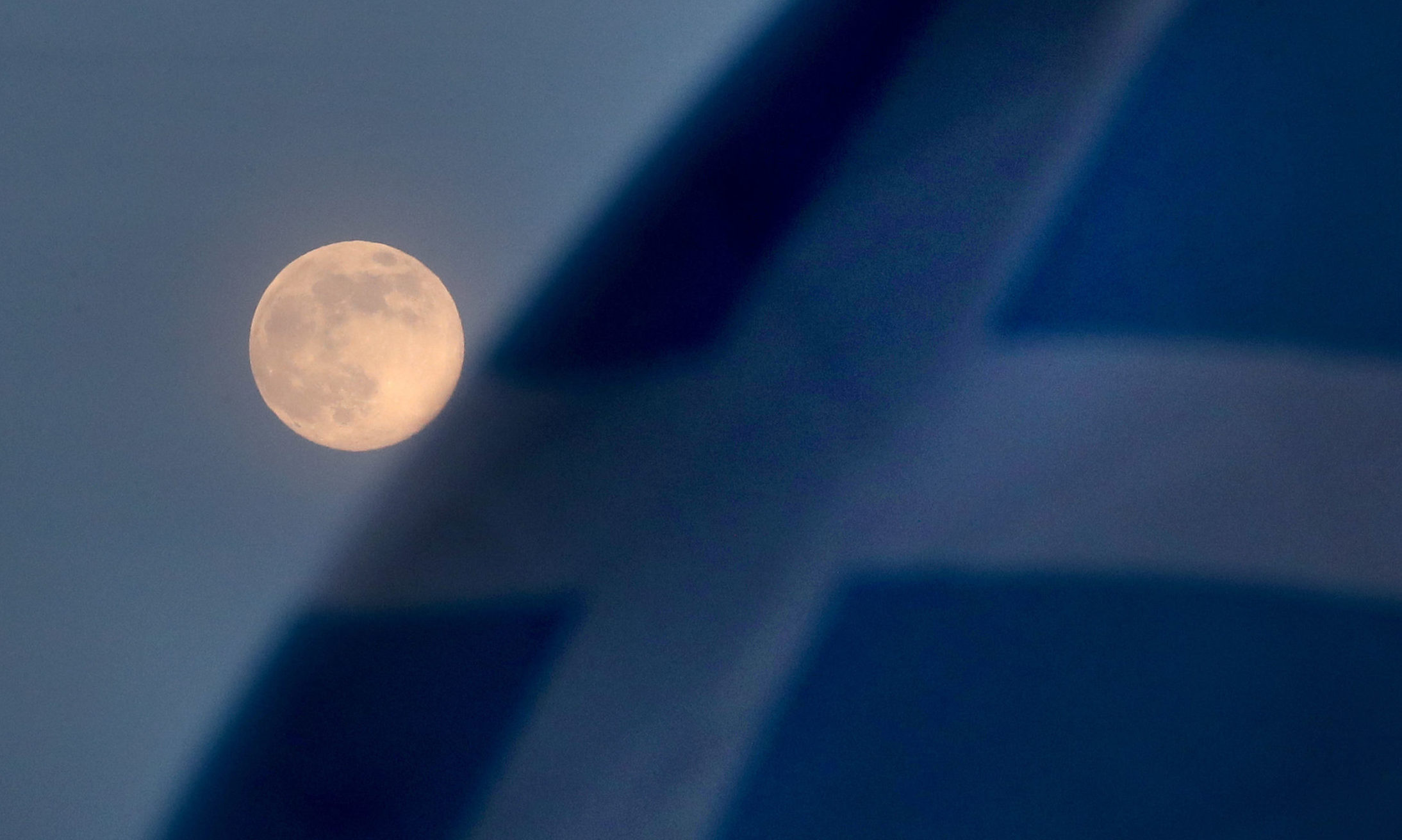 A pink supermoon is seen beside a Saltire flag in Falkirk.