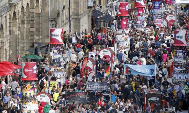 Fringe crowds on Edinburgh's Royal Mile.