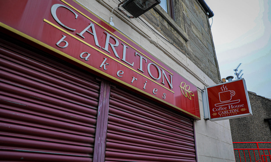 A closed and shuttered Carlton Bakery on Markinch High Street.