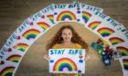 11 year old Maci Fotheringham has been painting rainbows as support for NHS while fundraising for Benarty Foodbank. But many people