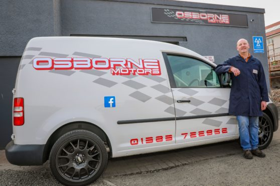 Michael Osborne (Owner) of Osborne Motors after replacing the tyres of a stranded NHS Nurse when her's had been slashed at her home in Dunfermline - Friday 10th April 2020 - Steve Brown / DCT Media