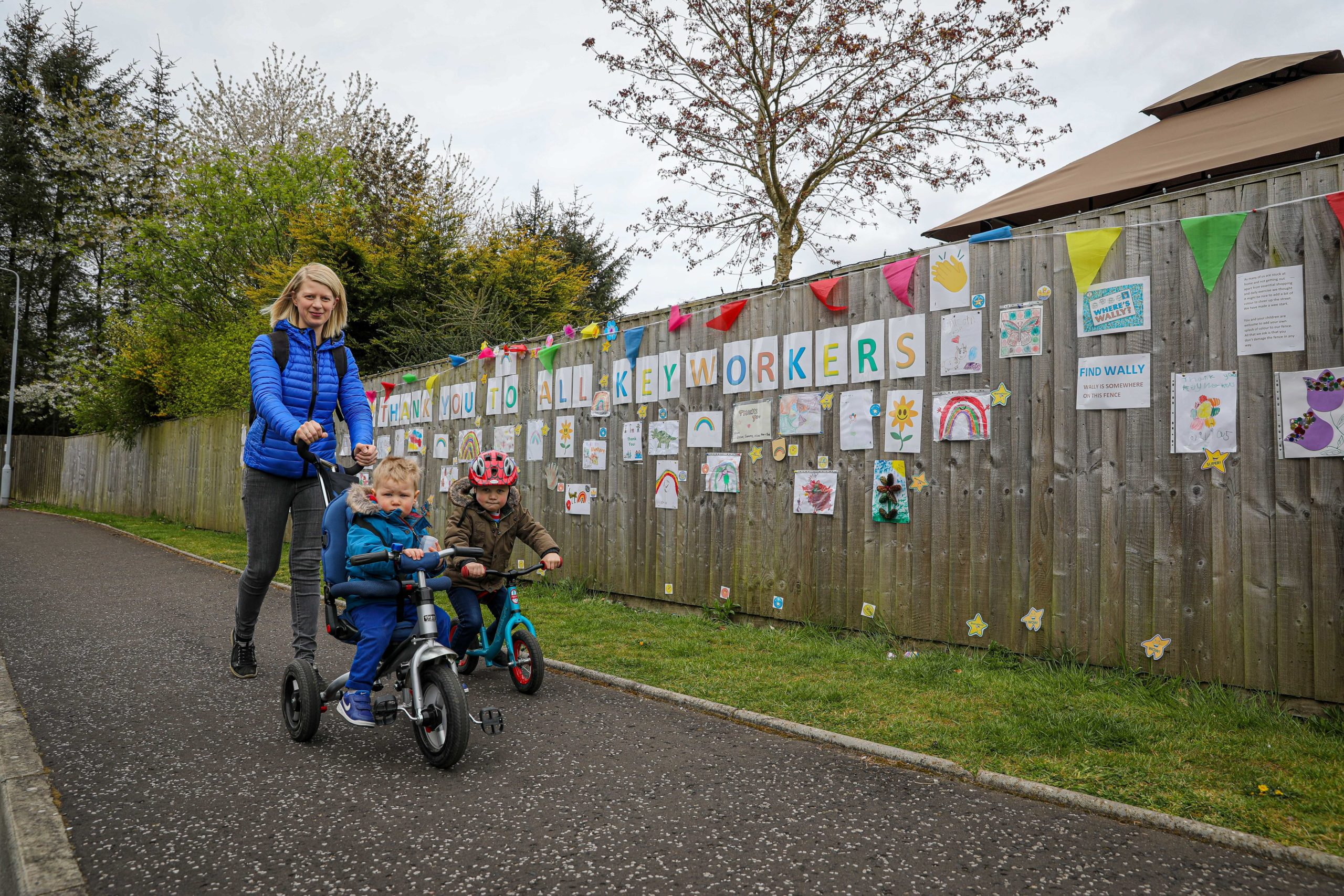 Tofthill residents, including Lisa Morris pictured with sons Rory, 3, and Austin, 1, are enjoying the estate's colourful wall of art.