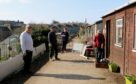 Social distancing queue at the allotments shop