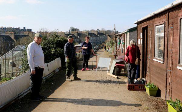 Social distancing queue at the allotments shop
