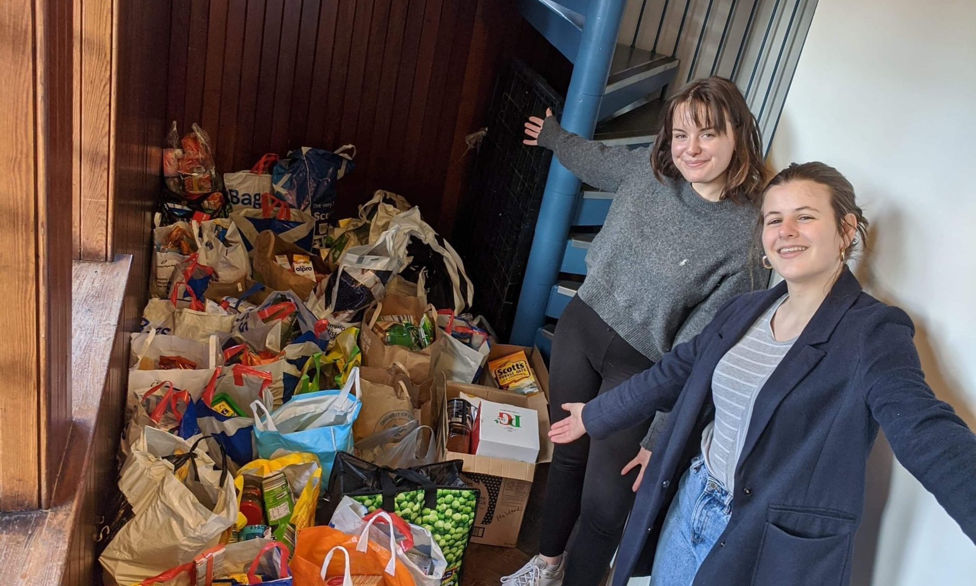 Students Lottie Doherty and Ruby Newsham with foodbank donations.