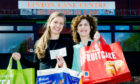 Mandy Henderson, right, with Harriet Morse from Aldi during a previous fundraising effort.