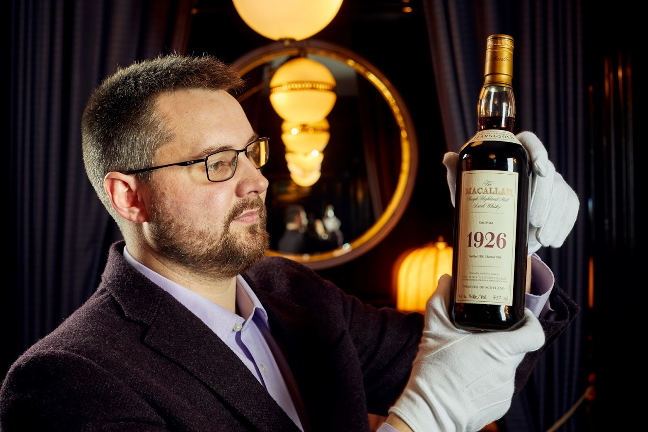 Whisky Auctioneer founder Iain McClune with the rare Macallan