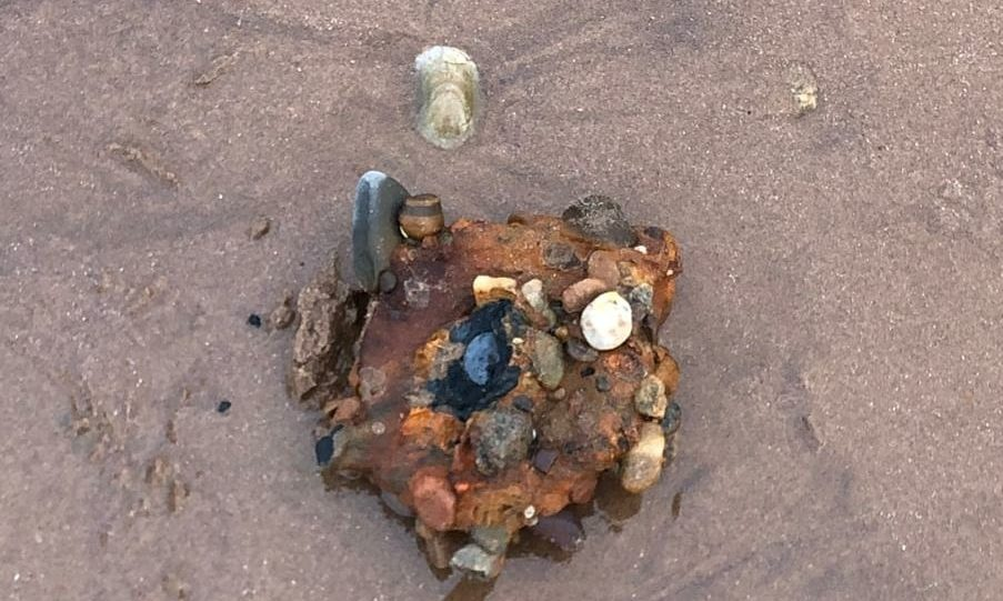 The land mine parts found on the beach