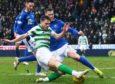 Jamie McCart tackles Celtic's James Forrest.