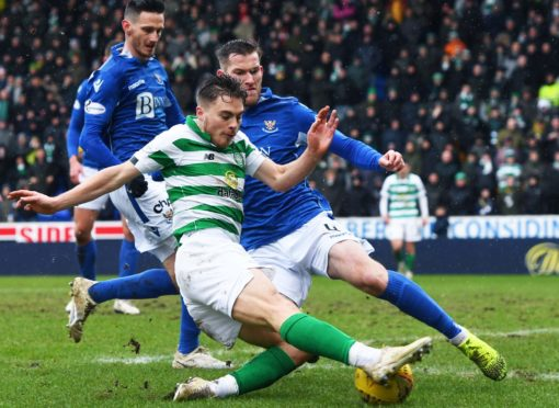 Jamie McCart tackles Celtic's James Forrest in a game last season.