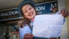 Caitlyn Yule, 10, with her letter asking to work at the butchers.