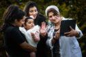 Aunties Yusra Ramzan, 20, Maliha Ramzan, 23, and granny Fatima Ramzan with baby Hoorain Siddiqui, 1 and a half doing a videocall with family to keep in touch.