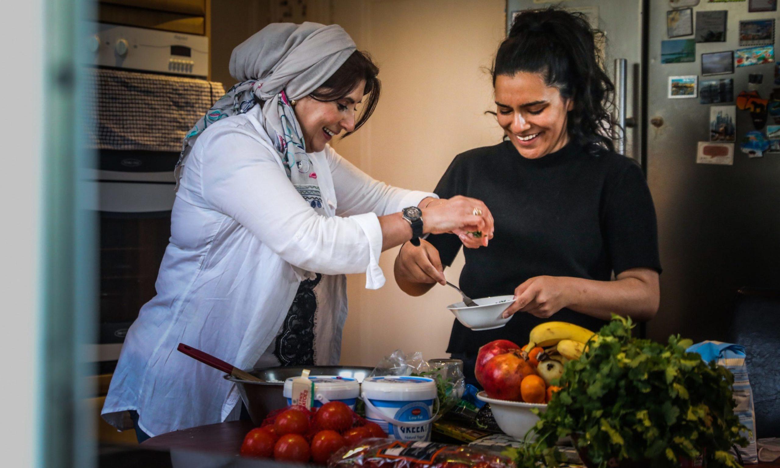 Fatima Ramzan with daughter Yusra Ramzan, 20 preparing some food for Ramadan.