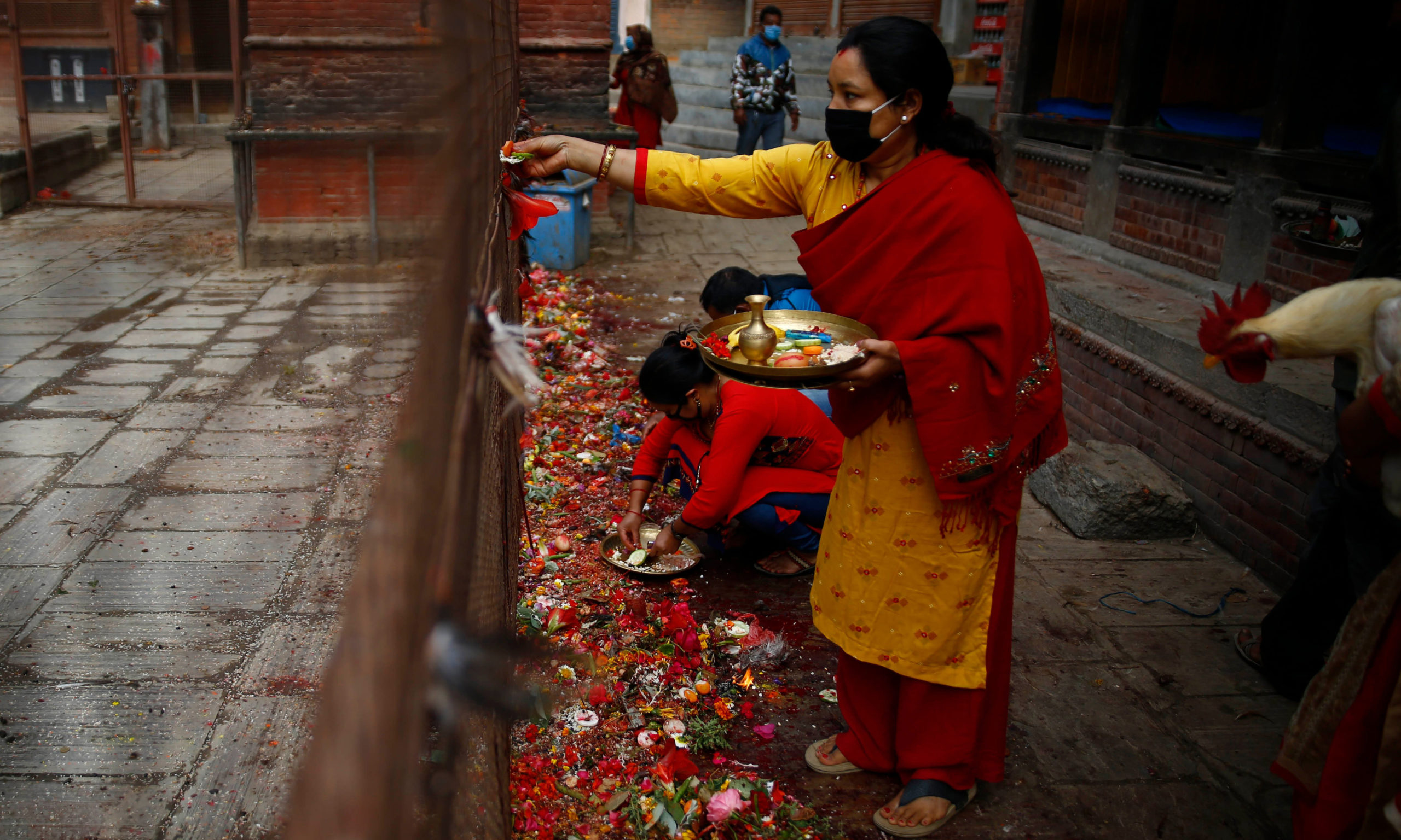 A small number of devotees offer prayers on the 22nd day of lockdown at Balkumari temple