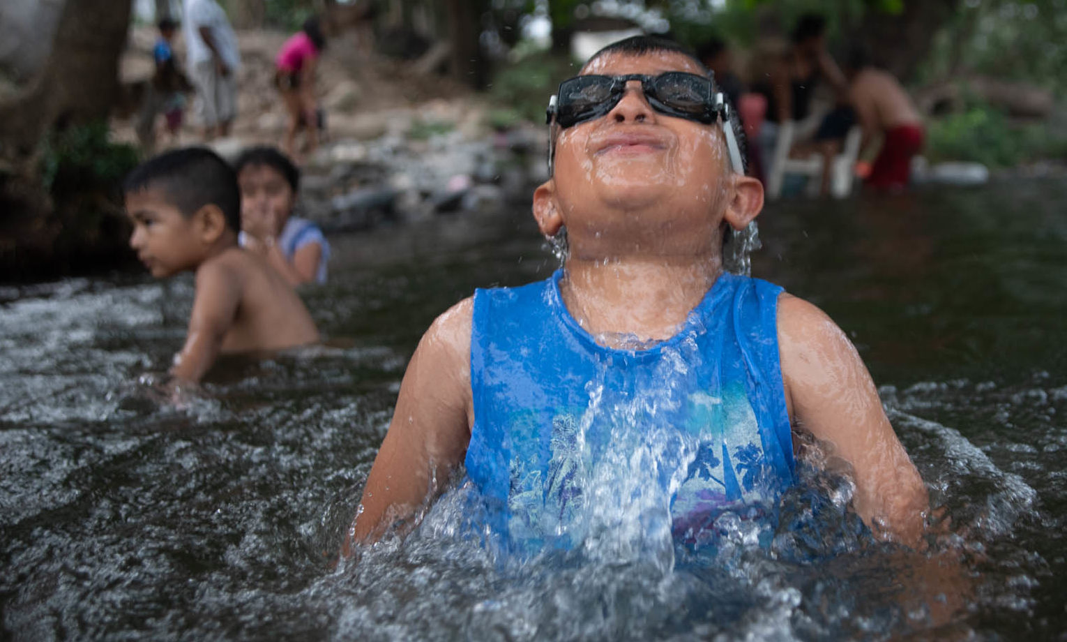 Mandatory Credit: Photo by Hector Adolfo Quintanar Perez/ZUMA Wire/Shutterstock (10608819a) Local children and their families take advantage of the fact that there are no tourists in their town to enjoy the waters of the River, closed to prevent the spread of COVID-19. This is how the inhabitants pass the quarantine. COVID-19: QUARANTINED: Mexico, Jalcomulco, Veracruz, México - 09 Apr 2020