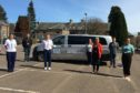 Staff from the transport hub with one of the donated vehicles