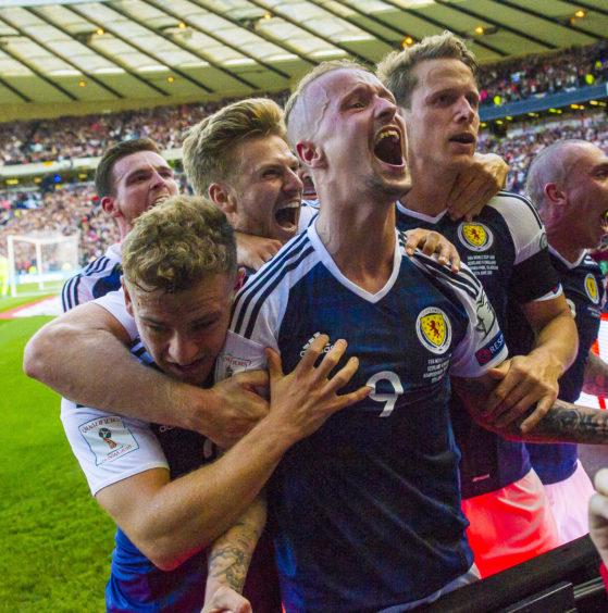 Scotland striker celebrates scoring second of his famous free-kick double