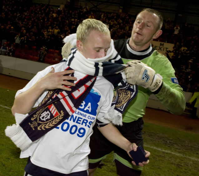 Leigh Griffiths and Rab Douglas celebrate 2009 Challenge Cup triumph with Dundee.