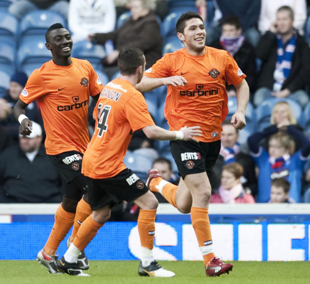 Andis Shala (right) rushes off to celebrate giving Dundee Utd the lead against Rangers in quarter-final
