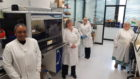 Some of the virology lab team at Ninewells Hospital with the new analyser