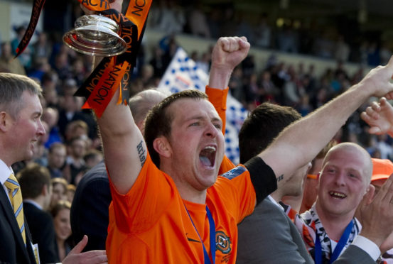 Andy Webster lifts the Scottish Cup at Hampden.