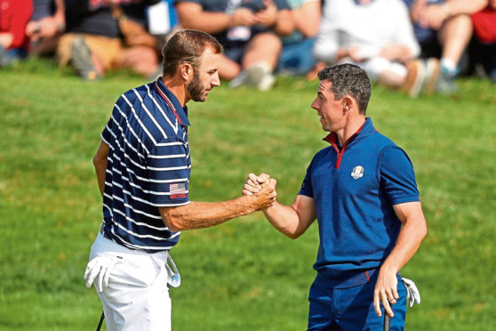 Mandatory Credit: Photo by Alastair Grant/AP/Shutterstock (10634055a) Dustin Johnson left, and Rory McIlroy shake hands on 16th green at the end of a fourball match on the opening day of the 42nd Ryder Cup in Saint-Quentin-en-Yvelines, outside Paris, France. Johnson and McIlroy headline a $3 million charity match for COVID-19 relief that will mark the first live golf on television since the pandemic shut down sports worldwide. The May 17 match will be played at Seminole Golf Club in South Florida Seminole Match Golf, Saint-Quentin-en-Yvelines, France - 28 Sep 2018