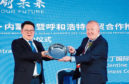 MengTai vice-chairman Ao Bo and Angus businessman Dave Valentine holding a quaich inscribed with the message 'together we will make the dream a reality'.