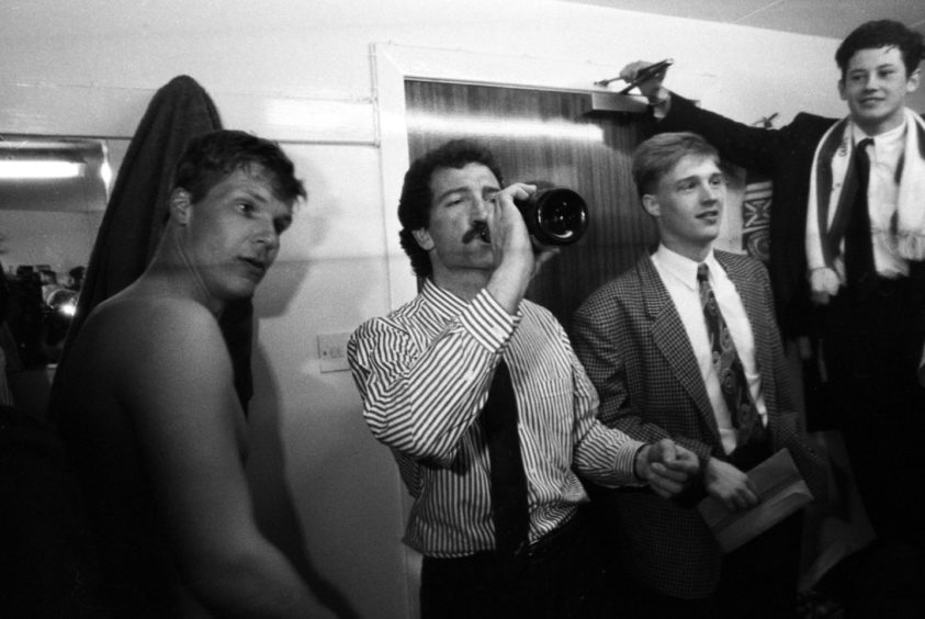 Graeme Souness celebrates his side's championship win alongside Chris Woods (left), Colin West and Sandy Robertson (right) at Tannadice in 1990.