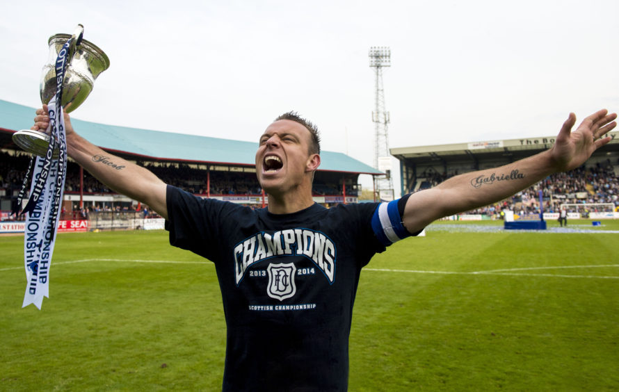 Dundee skipper Gavin Rae celebrates winning Championship