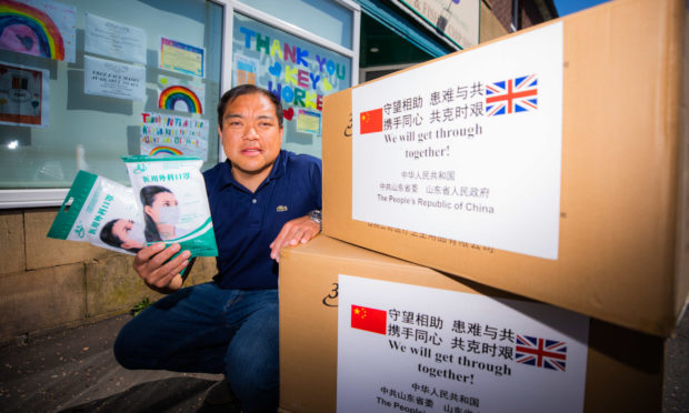 Andy Chan with boxes of facemasks