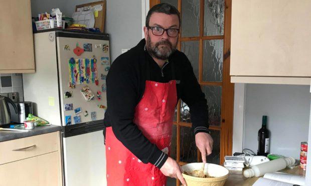 Graeme 'Beef' Cunningham at work in the kitchen