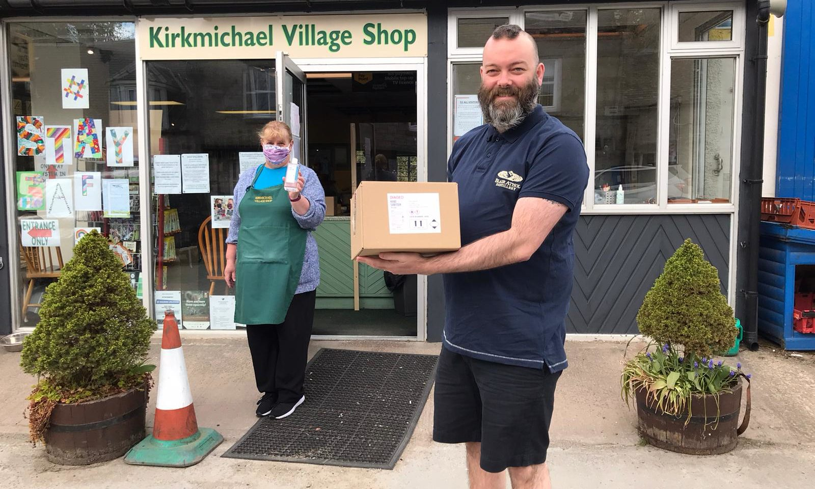 Blair Athol Distillery employees distribute free hand sanitiser to Kirkmichael Village Shop