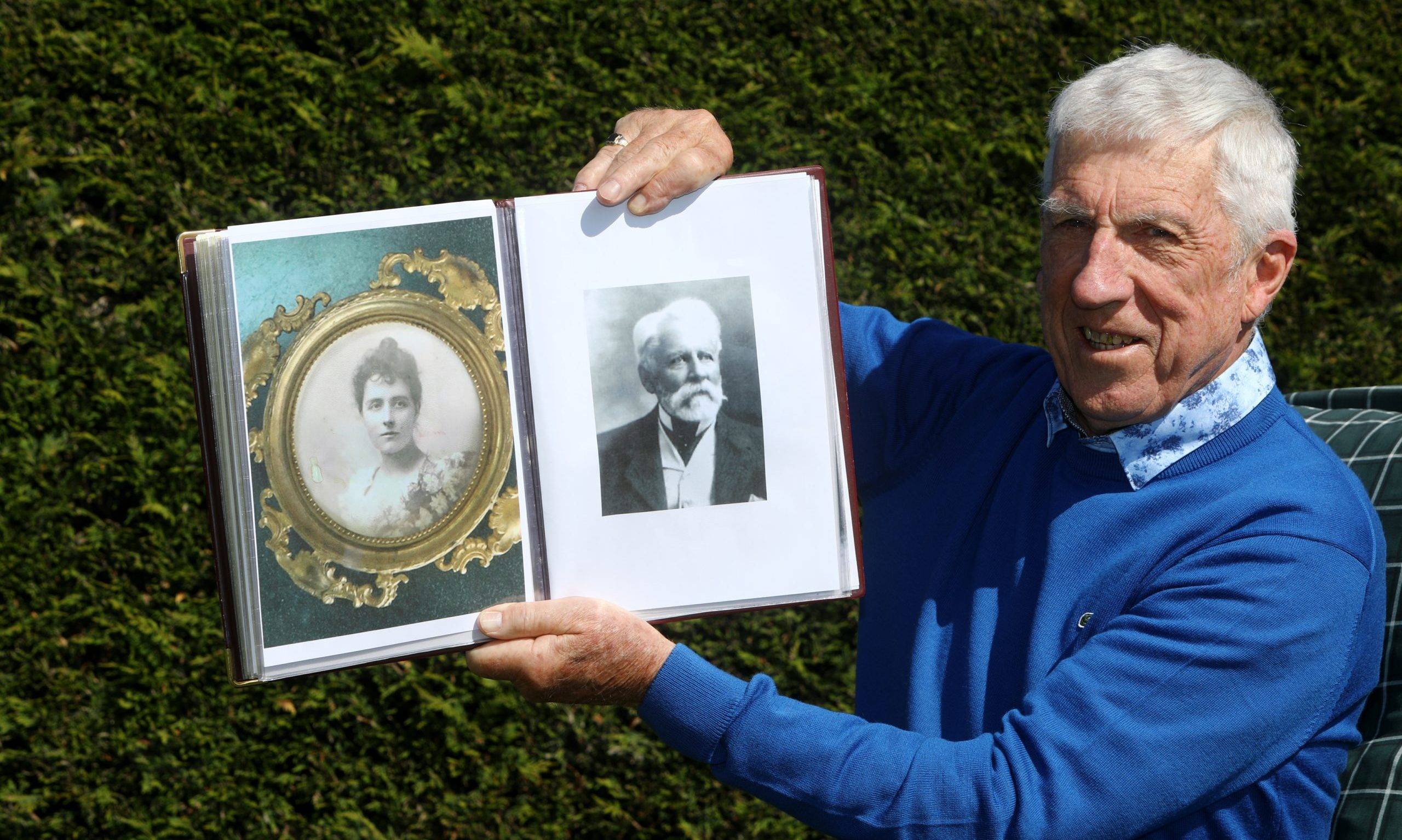 Ladybank Golf Club historian Bob Drummond at home in Ladybank today, holding photos of Catherine Maitland Soues and her husband F.W. Foster