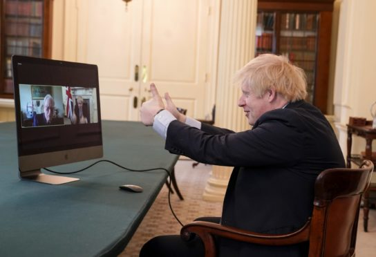 08/05/2020. London, United Kingdom. Boris Johnson VE Day 75th Anniversary. The Prime Minister Boris Johnson speaks to War veteran Ernie Horsfall 102,  from the cabinet room of  No10 Downing Street on the 75th Anniversary of VE Day. Ernie served in the Army from 1940 to 1946 as part of the Royal Electrical and Mechanical Engineers (REME). Picture by Andrew Parsons / No 10 Downing Street