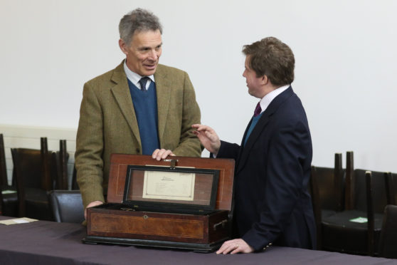 Bonhams Scotland managing director Charles Graham-Campbell and senior valuer Hamish Wilson at Culloden in 2019