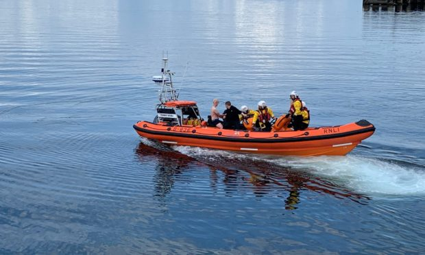The men safely in the lifeboat.