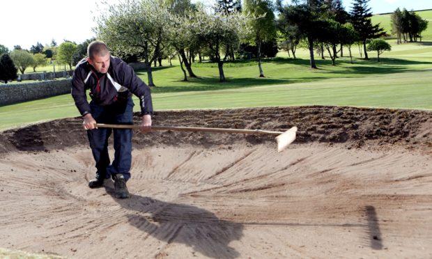 Cupar Golf Club head greenkeeper Gary Douglas hard at work