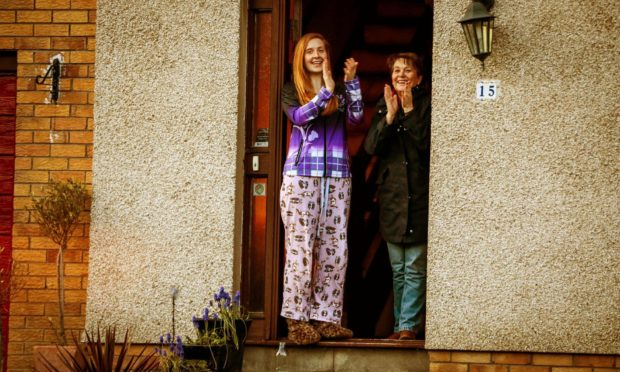 Courier News - Fife - No Reporter - Clapping for NHS - No Job Number - Glenrothes - Picture Shows: Kirsty Stewart (26) from Glenrothes who is clapping for the NHS while still hoping to get married in July, with her mum Heather Stewart. Kirsty dad Gordon is an NHS worker - Thursday 2nd April 2020 - Steve Brown / DCT Media - Thursday 2nd April 2020 - Steve Brown / DCT Media