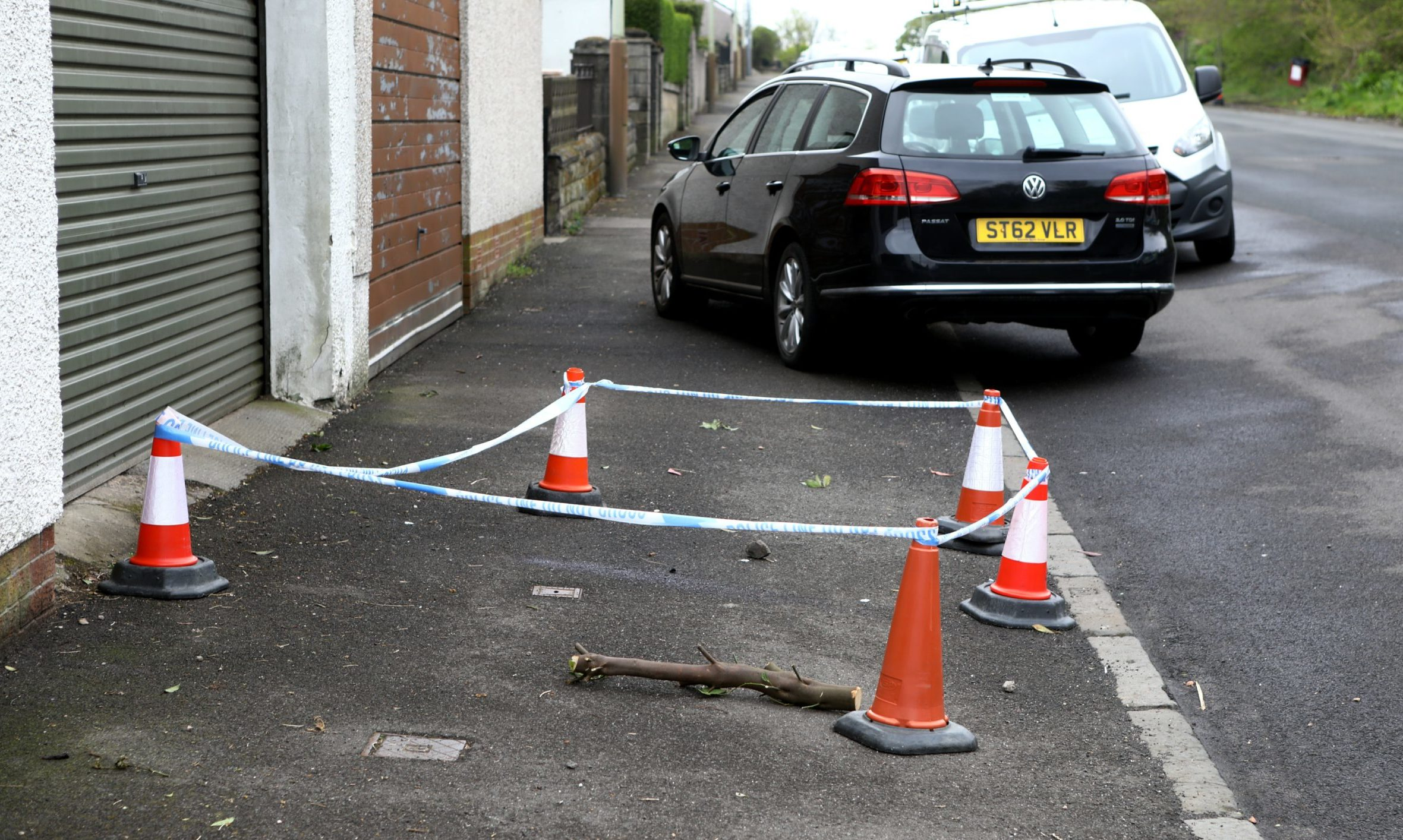 The scene at Kinghorne Road in Dundee where a man collapsed before his death.