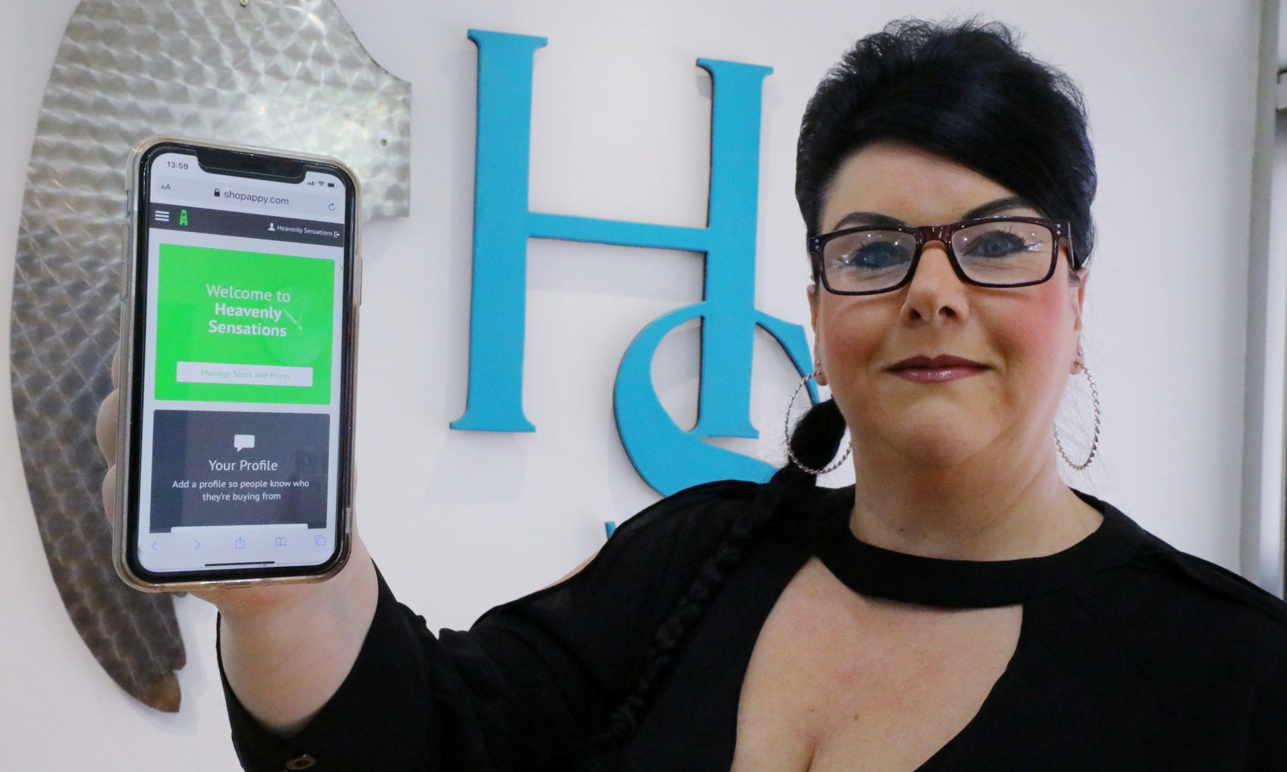 Amanda Allan from Heavenly Sensations salon demonstrates the app.