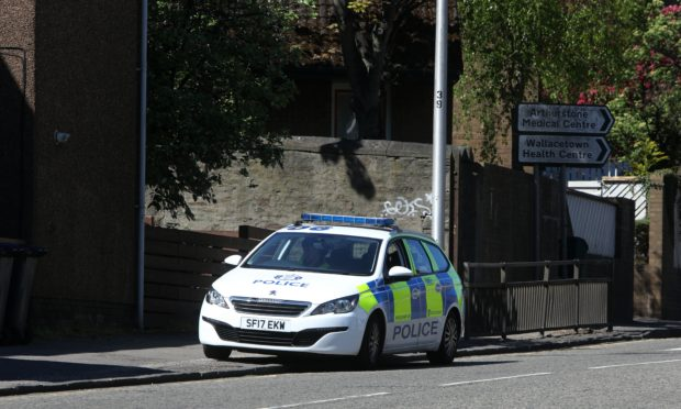 The police vehicle sitting on Dens Road in Dundee on May 6.