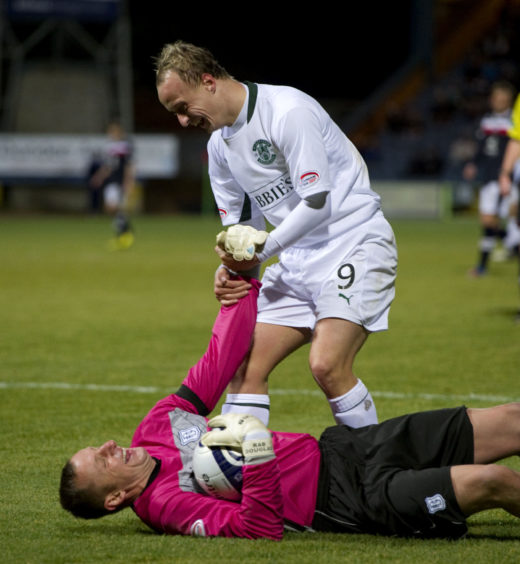 Griffiths - in action for Hibs against Dundee - jokes around with former team-mate Rab Douglas