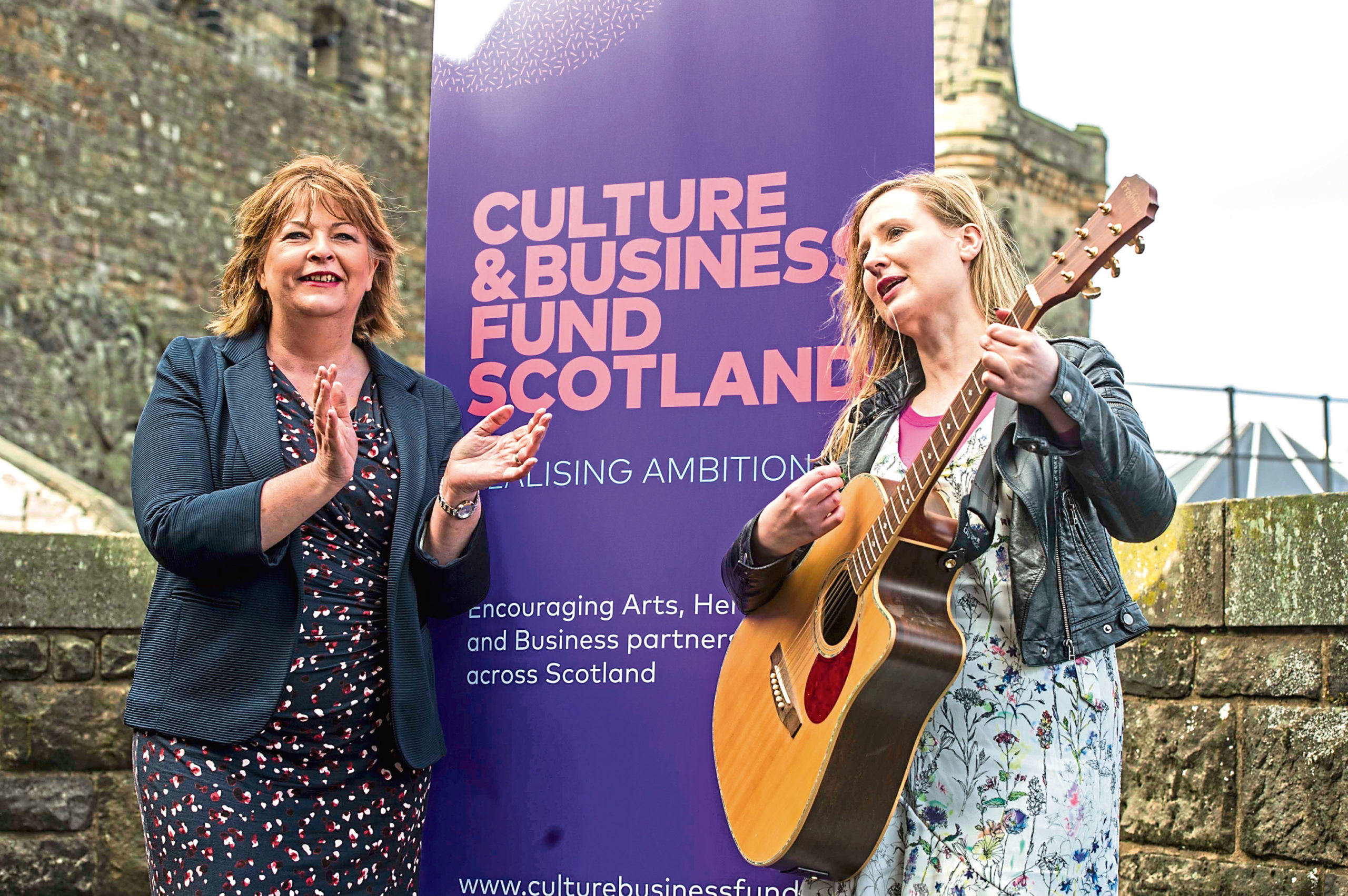 Fiona Hyslop and musician Louise Quinn.