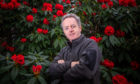 Ken Cox pictured a year ago alongside Rhododendron Taurus at Glendoick Garden Centre, Glencarse, near Perth.