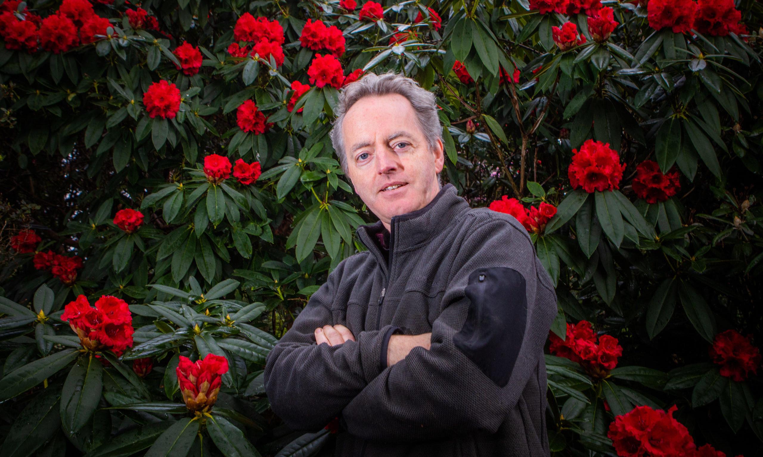 Ken Cox pictured a year ago alongside Rhododendron Taurus at Glendoick Garden Centre, Glencarse, near Perth.