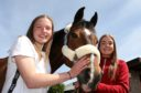 Rebekah Walker and Jessica Murray with Jessica's horse, Diva.