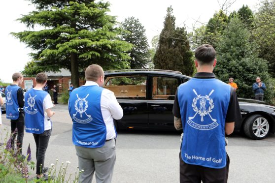 The funeral of Ralf Coutts  at Dundee Crematorium with St Andrews caddies and Keptie Friends clapping the hearse.