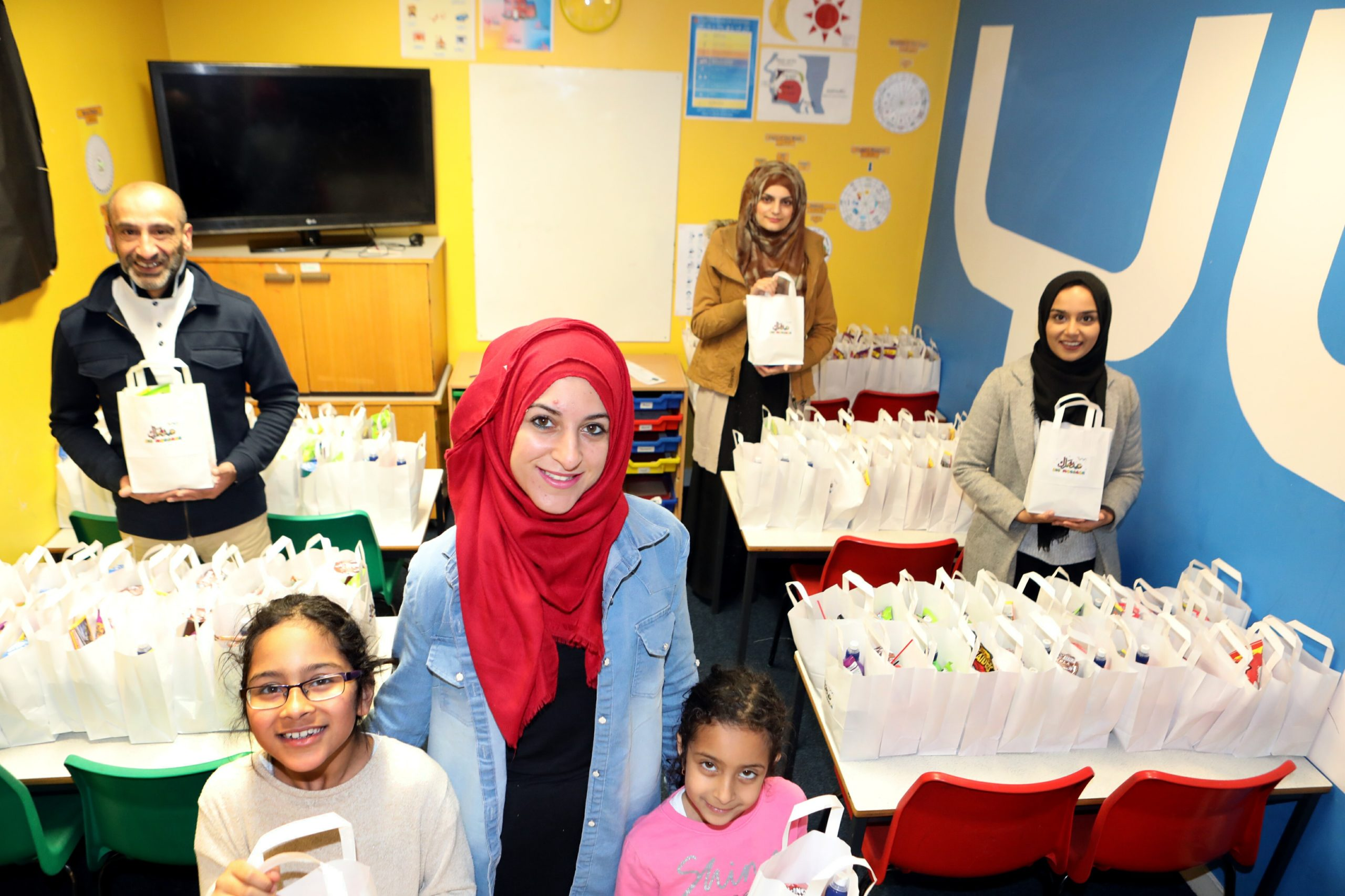 YYI helpers on Saturday with hundreds of food packages